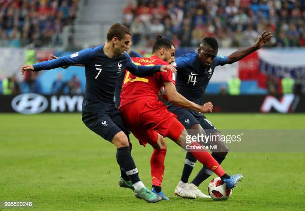 Nacer Chadli of Belgium is challenged by Antoine Griezmann of France and Blaise Matuidi of France during the 2018 FIFA World Cup Russia Semi Final...