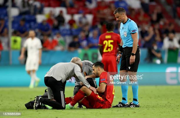 Nacer Chadli of Belgium receives medical treatment during the UEFA Euro 2020 Championship Quarter-final match between Belgium and Italy at Football...