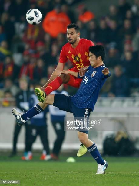 Nacer Chadli of Belgium Ryota Morioka of Japan during the International Friendly match between Belgium v Japan at the Jan Breydel Stadium on November...