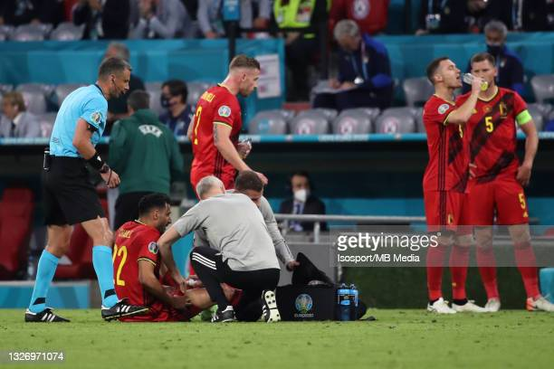 Nacer Chadli of Belgium suffers an injury during the UEFA Euro 2020 Championship Quarter-final match between Belgium and Italy at Football Arena...