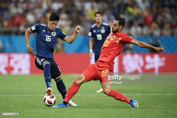 Nacer Chadli of Belgium tackles Hotaru Yamaguchi of Japan during the 2018 FIFA World Cup Russia Round of 16 match between Belgium and Japan at Rostov...