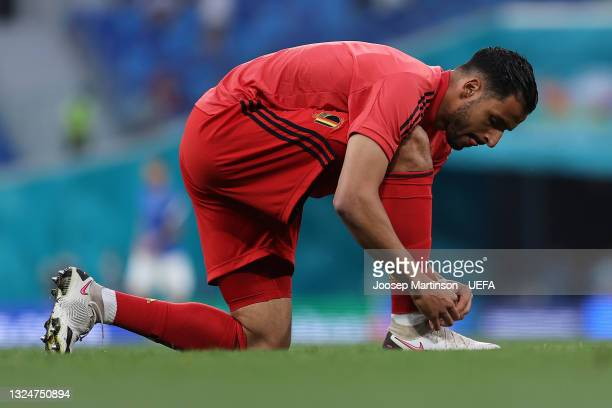 Nacer Chadli of Belgium ties his shoelace as he warms up prior to the UEFA Euro 2020 Championship Group B match between Finland and Belgium at Saint...
