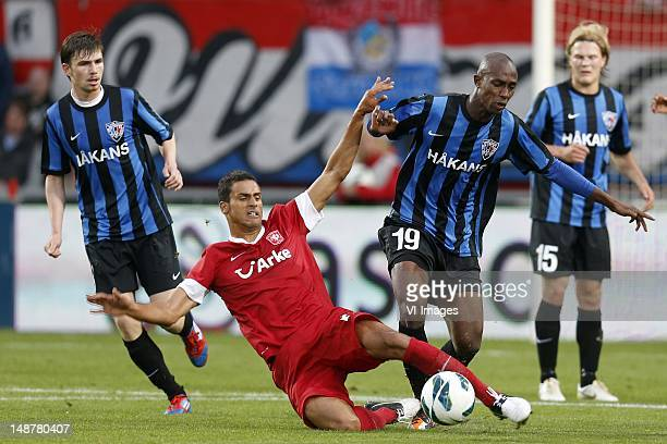 Nacer Chadli of FC Twente Babacar Diallo of FC Inter Turku during the Europa League Playoff match between FC Twente and Inter Turku at De Grolsch...