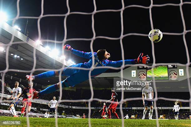 Nacer Chadli of Spurs beats goalkeeper Lukasz Fabianski of Swansea City to score their first goal during the Barclays Premier League match between...