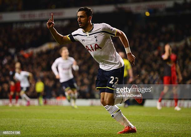 Nacer Chadli of Spurs celebrates as he score their first goal during the Barclays Premier League match between Tottenham Hotspur and Swansea City at...