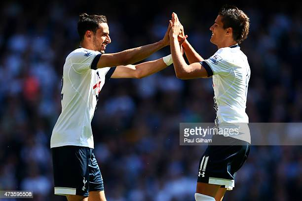 Nacer Chadli of Spurs celebrates scoring his team's first goal with his team mate Erik Lamela during the Barclays Premier League match between...