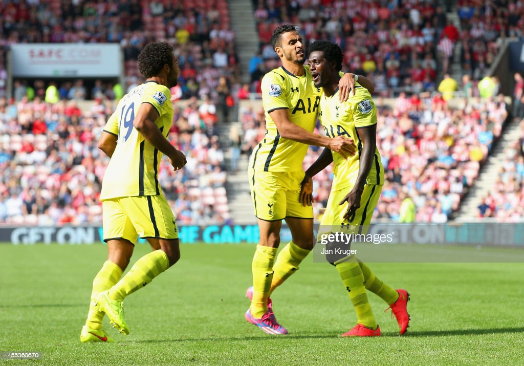 Nacer Chadli of Spurs (C) celebrates scoring the opening goal with Mousa Dembele and Emmanuel Adebayour of Spurs during the Barclays Premier League match between Sunderland and Tottenham Hotspur at Stadium of Light on September 13, 2014 in Sunderland, England.