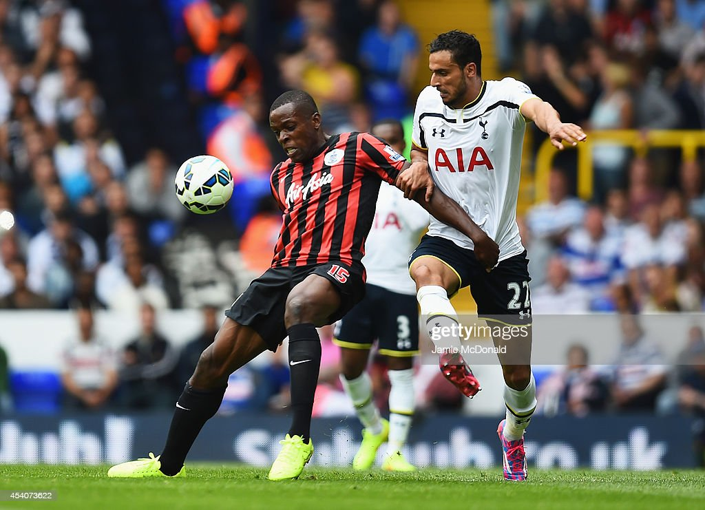 Nacer Chadli of Spurs challenges Nedum Onuoha of QPR during the Barclays Premier League match between Tottenham Hotspur and Queens Park Rangers at White Hart Lane on August 24, 2014 in London, England.