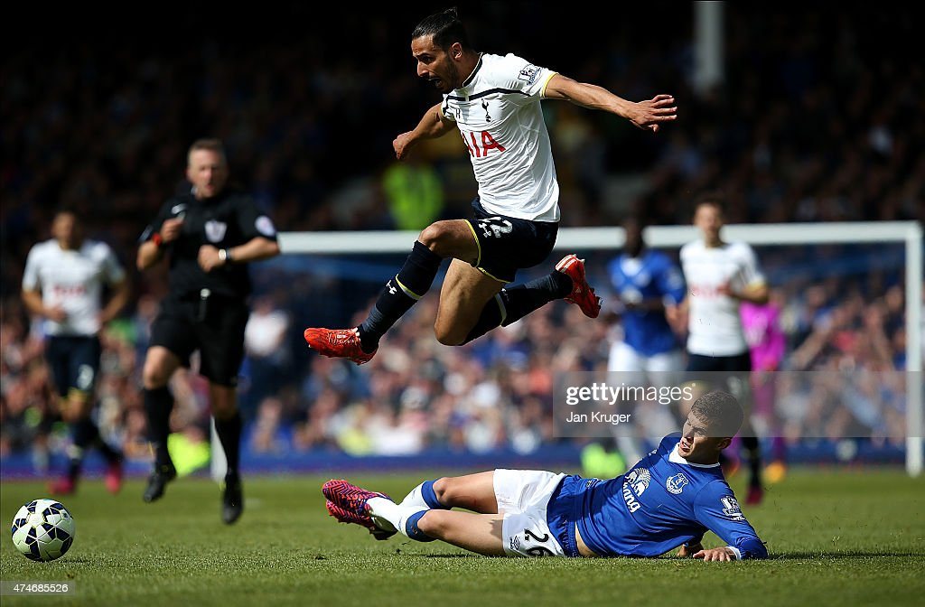 Nacer Chadli of Spurs leaps the tackle of John Stones of Everton during the Barclays Premier League match between Everton and Tottenham Hotspur at Goodison Park on May 24, 2015 in Liverpool, England.