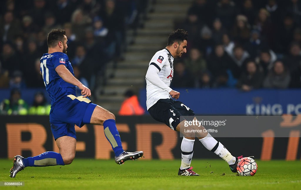 Nacer Chadli of Spurs scores his team's second goal as Marcin Wasilewski of Leicester City closes in during the Emirates FA Cup Third Round Replay match between Leicester City and Tottenham Hotspur at The King Power Stadium on January 20, 2016 in Leicester, England.