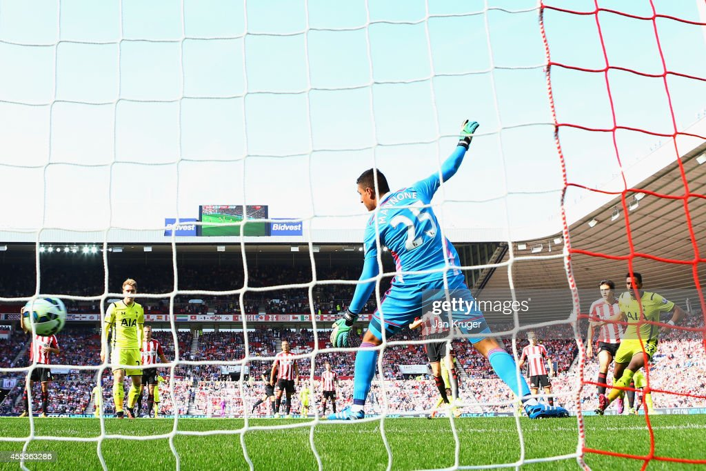 Nacer Chadli of Spurs scores the opening goal past Vito Mannone of Sunderland during the Barclays Premier League match between Sunderland and Tottenham Hotspur at Stadium of Light on September 13, 2014 in Sunderland, England.