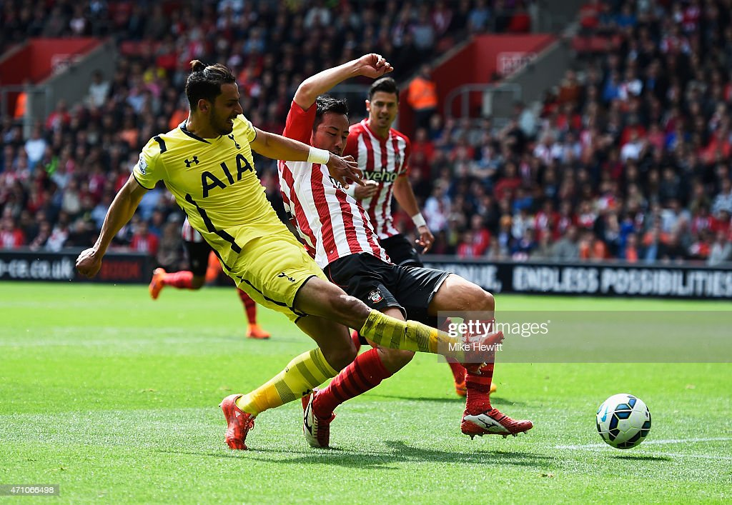 Nacer Chadli of Spurs shoots past Maya Yoshida of Southampton to score their second goal during the Barclays Premier League match between Southampton and Tottenham Hotspur at St Mary's Stadium on April 25, 2015 in Southampton, England.