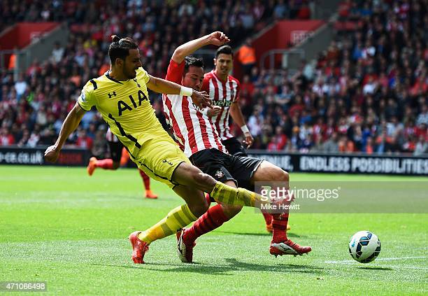 Nacer Chadli of Spurs shoots past Maya Yoshida of Southampton to score their second goal during the Barclays Premier League match between Southampton...