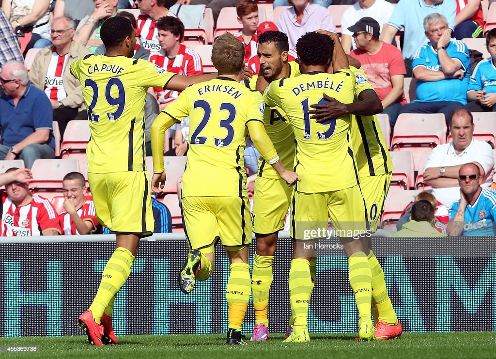 Nacer Chadli of Tottenham (facing) celebrates scoring the opening goal during the Barclays Premier League match between Sunderland AFC and Tottenham Hotspur at The Stadium of Light on September 13, 2014 in Sunderland, England.