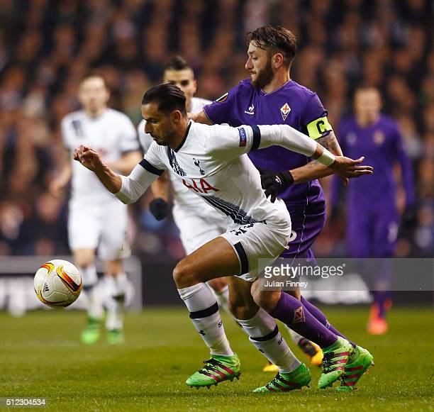 Nacer Chadli of Tottenham Hotspur and Gonzalo Rodriguez of Fiorentina compete for the ball during the UEFA Europa League round of 32 second leg match...
