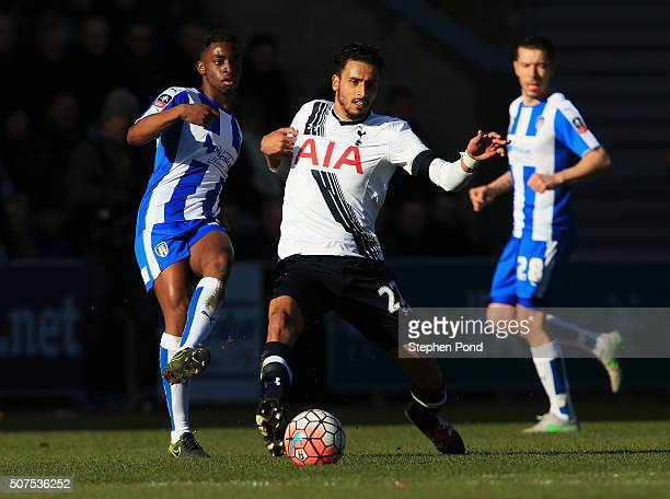 Nacer Chadli of Tottenham Hotspur and Kane VincentYoung of Colchester United compete for the ball during the Emirates FA Cup Fourth Round match...