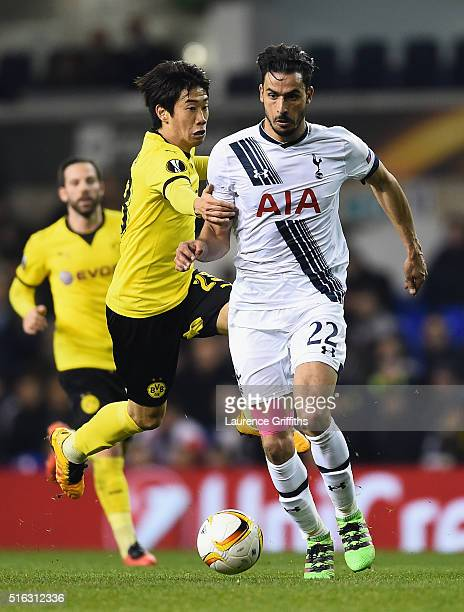Nacer Chadli of Tottenham Hotspur battles with the ball with Shinji Kagawa of Borrussia Dortmund during the UEFA Europa League Round of 16 second leg...