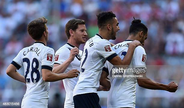 Nacer Chadli of Tottenham Hotspur celebrates as he scores the opening goal during the Audi Cup 2015 match between Tottenham Hotspur and AC Milan at...
