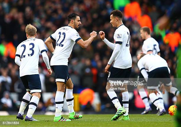 Nacer Chadli of Tottenham Hotspur celebrates scoring his goal with Dele Alli during the Barclays Premier League match between Tottenham Hotspur and...