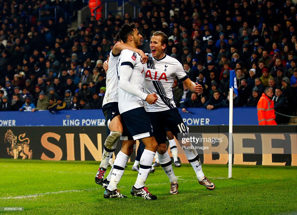 Nacer Chadli of Tottenham Hotspur celebrates with Harry Kane of Tottenham Hotspur after scoring to make it 0-2 during The Emirates FA Cup Third Round Replay match between Leicester City and Tottenham at the King Power Stadium on January 20, 2016 in Leicester, United Kingdom.