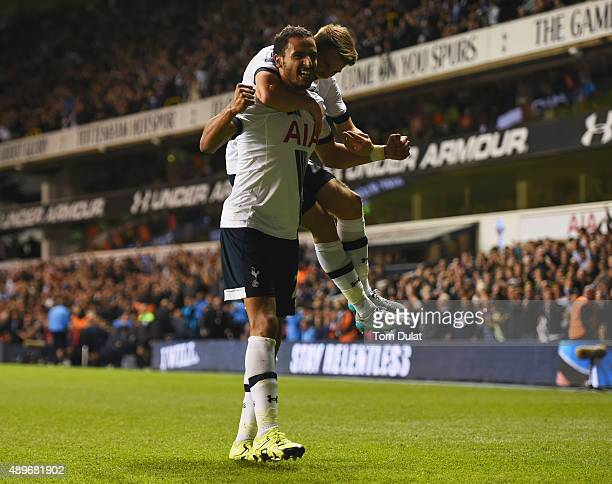 Nacer Chadli of Tottenham Hotspur celebrates with Tommy Carroll as Calum Chambers of Arsenal scores an own goal foe their first goal during the...