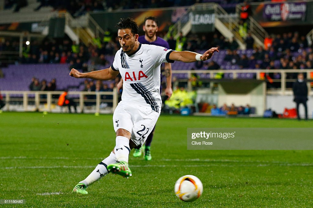 Nacer Chadli of Tottenham Hotspur converts the penalty kick to score his team's first goal during the UEFA Europa League round of 32 first leg match between Fiorentina and Tottenham Hotspur at Stadio Artemio Franchi on February 18, 2016 in Florence, Italy.