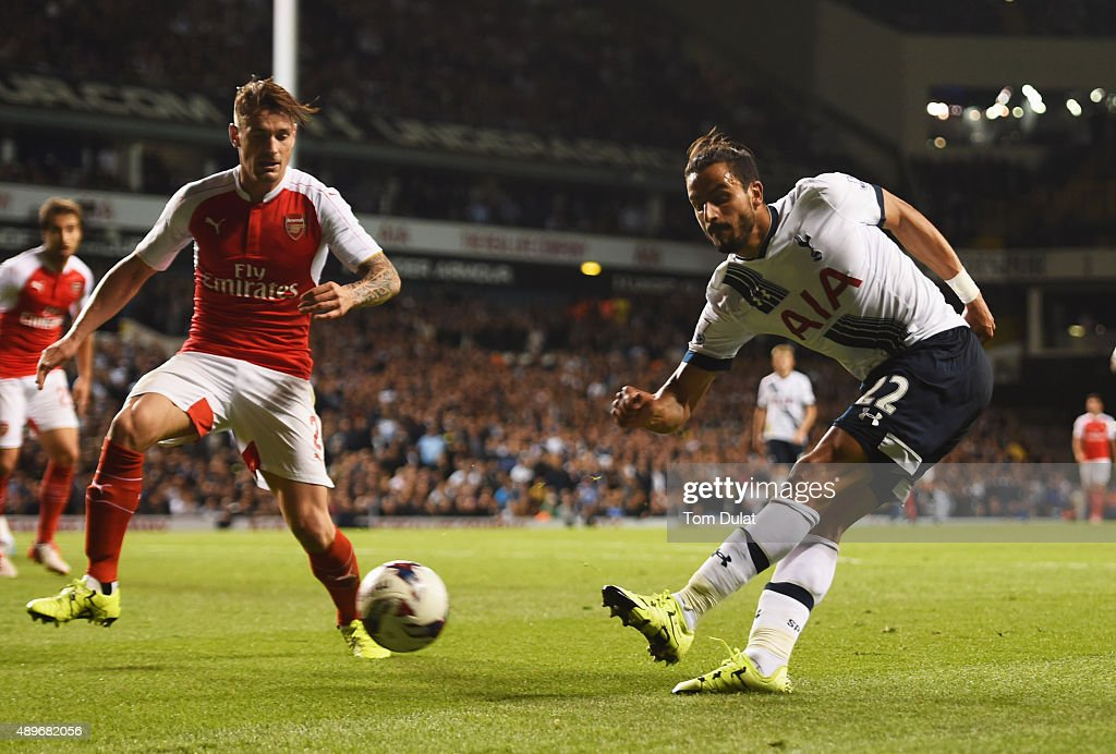 Nacer Chadli of Tottenham Hotspur crosses the ball which deflects off of Calum Chambers of Arsenal (not pictured) for an own goal for Spurs' first goal during the Capital One Cup third round match between Tottenham Hotspur and Arsenal at White Hart Lane on September 23, 2015 in London, England.