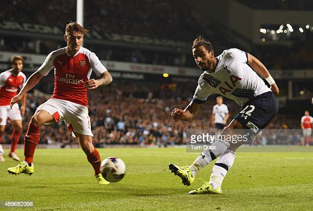 Nacer Chadli of Tottenham Hotspur crosses the ball which deflects off of Calum Chambers of Arsenal for an own goal for Spurs' first goal during the...