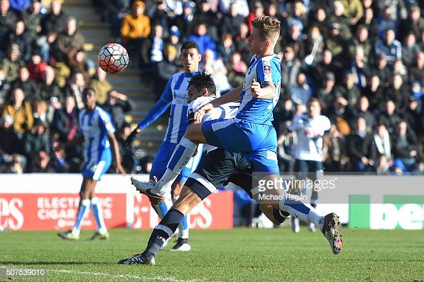 Nacer Chadli of Tottenham Hotspur heads the ball to score his team's third goal during the Emirates FA Cup Fourth Round match between Colchester...