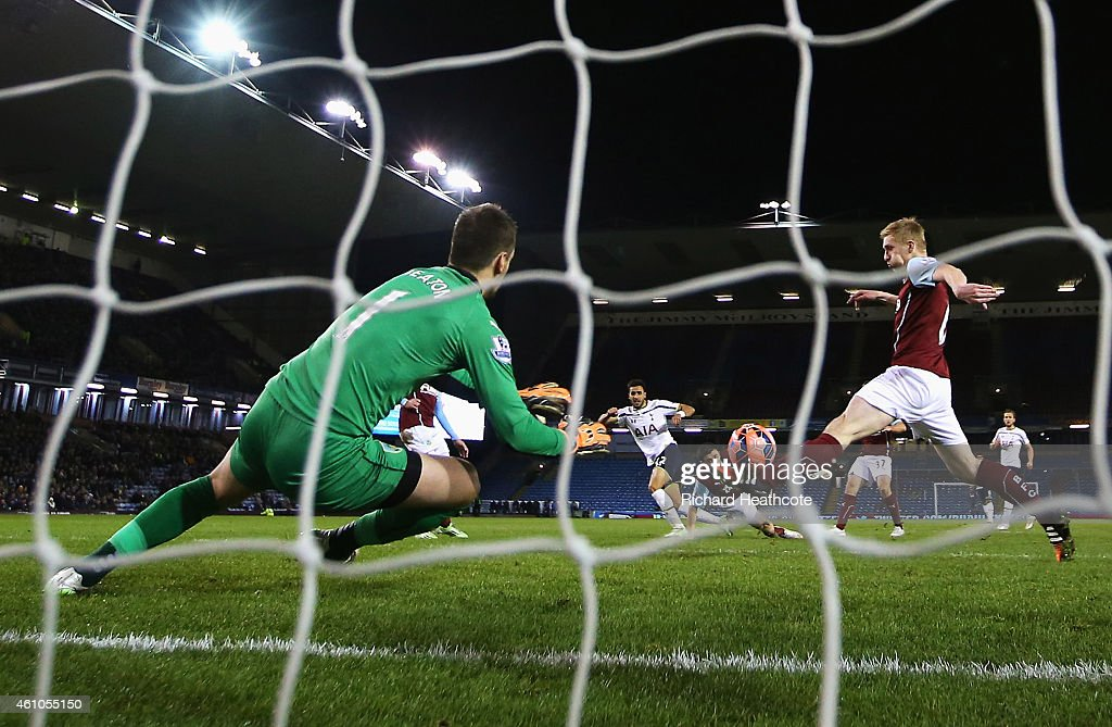 Nacer Chadli of Tottenham Hotspur scores past Thomas Heaton of Burnley during the FA Cup Third Round match between Burnley and Tottenham Hotspur at Turf Moor on January 5, 2015 in Burnley, England.