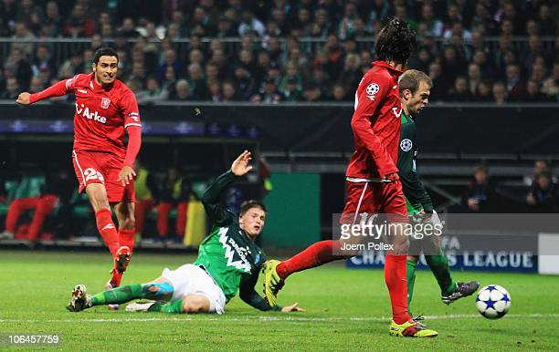 Nacer Chadli of Twente scores his team's first goal during the UEFA Champions League group A match between SV Werder Bremen and FC Twente at Weser...
