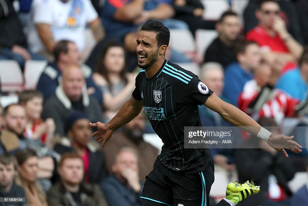 Nacer Chadli of West Bromwich Albion celebrates after scoring a goal to make it 0-1 during the Premier League match between Sunderland and West Bromwich Albion at Stadium of Light on October 1, 2016 in Sunderland, England.