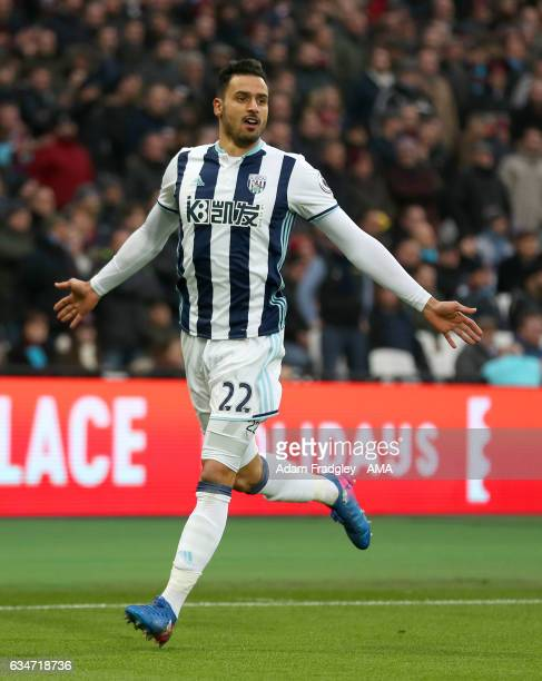 Nacer Chadli of West Bromwich Albion celebrates after scoring a goal to make it 01 during the Premier League match between West Ham United and West...
