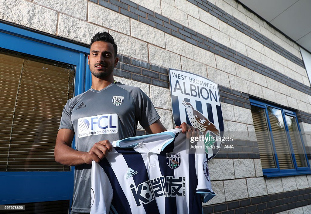 Nacer Chadli signs for WBA at West Bromwich Albion Training Ground on August 29, 2016 in Walsall, England.