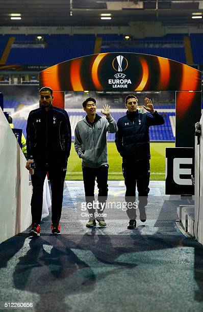 Nacer Chadli Son Heungmin and Kevin Wimmer walk down the tunnel prior tothe UEFA Europa League round of 32 second leg match between Tottenham Hotspur...