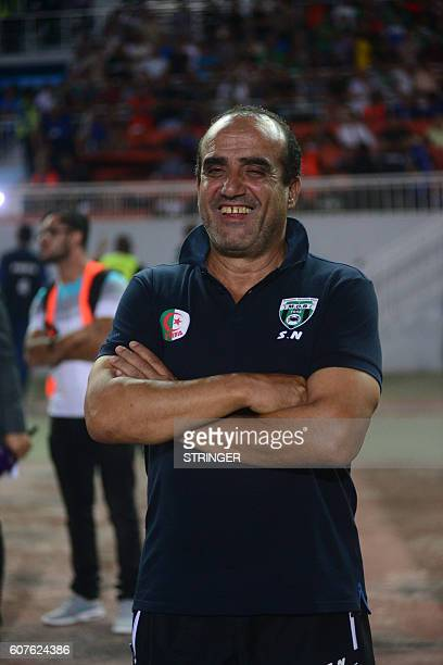 Nacer Sandjak the head coach of MO Bejaia smiles before the first leg of the 2016 Caf Confederation Cup semifinal against Rabat at the Stade de...