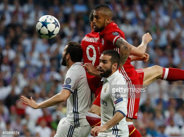 Nacho and Carvajal of Real Madrid and Arturo Vidal of Bayern Muenchen battle for the ball during the UEFA Champions League Quarter Final second leg...
