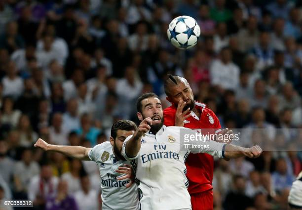 Nacho Carvajal of Real Madrid and Arturo Vidal of Bayern Muenchen battle for the ball during the UEFA Champions League Quarter Final second leg match...