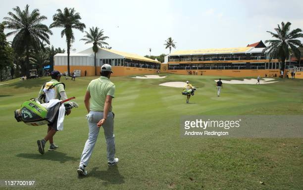 Nacho Elvira of Spain and his caddie Diego Suazo approach the 18th green on Day Three of the Maybank Championship at Saujana Golf Country Club Palm...