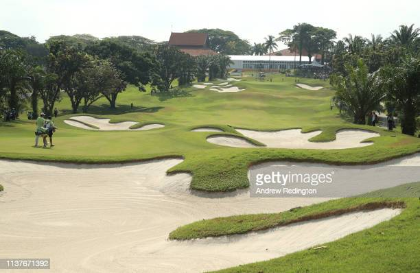 Nacho Elvira of Spain and his caddie walk down on the second hole on Day Three of the Maybank Championship at Saujana Golf Country Club Palm Course...