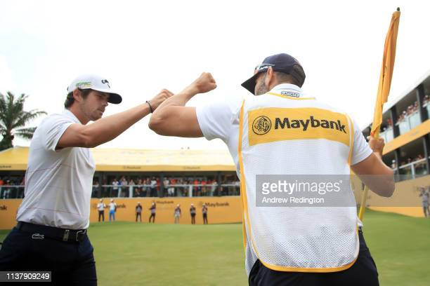 Nacho Elvira of Spain celbrates after he holds his putt to force a play off match during Day Four of the Maybank Championship at Saujana Golf Country...