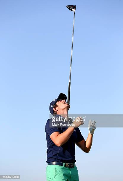 Nacho Elvira of Spain juggles his club on his chin whilst waiting to play off the 16th tee during the final practice round of the 2015 Alfred Dunhill...