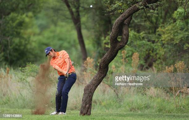Nacho Elvira of Spain plays his approach shot on the 11th hole during Day One of the South African Open at Gary Player CC on December 03, 2020 in Sun...