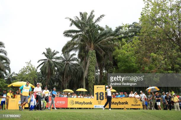 Nacho Elvira of Spain plays his shot off the 18th tee during Day Four of the Maybank Championship at Saujana Golf Country Club Palm Course on March...