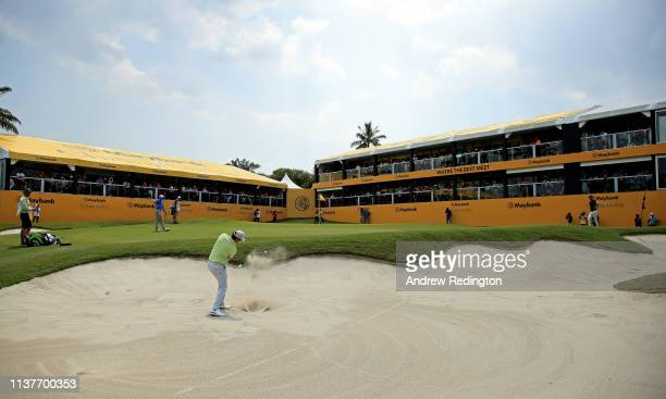 Nacho Elvira of Spain waves to the crowd after his birdie on the 18th green on Day Three of the Maybank Championship at Saujana Golf Country Club...