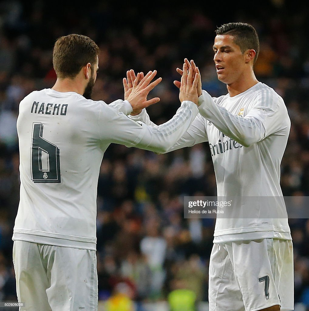 Nacho Fernandez (L) and Cristiano Ronaldo of Real Madrid celebrate after scoring during the La Liga match between Real Madrid CF and Real Sociedad at Estadio Santiago Bernabeu on December 30, 2015 in Madrid, Spain.