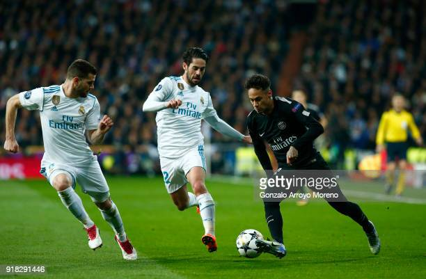 Nacho Fernandez and Isco of Real Madrid close down Neymar of PSG in action during the UEFA Champions League Round of 16 First Leg match between Real...
