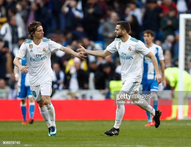 Nacho Fernandez and Luka Modric of Real Madrid celebrate after scoring during the La Liga match between Real Madrid CF and Deportivo La Corua at...