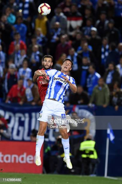 Nacho Fernandez of Real Madrid battles with Guido Carrillo of Leganes during the La Liga match between CD Leganes and Real Madrid CF at Estadio...
