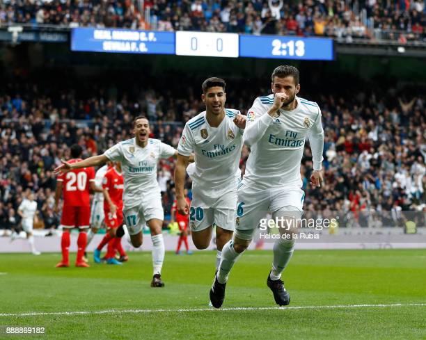 Nacho Fernandez of Real Madrid celebrates after scoring during the La Liga match between Real Madrid and Sevilla at Estadio Santiago Bernabeu on...